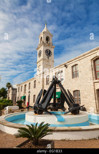 The clocktower building and anchor monument at the Royal Naval Dockyard, Bermuda. - Stock Image