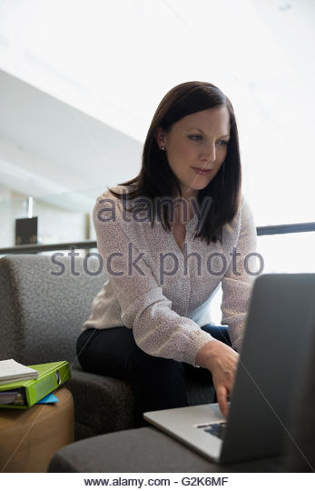 Adult education student using laptop - Stock Image