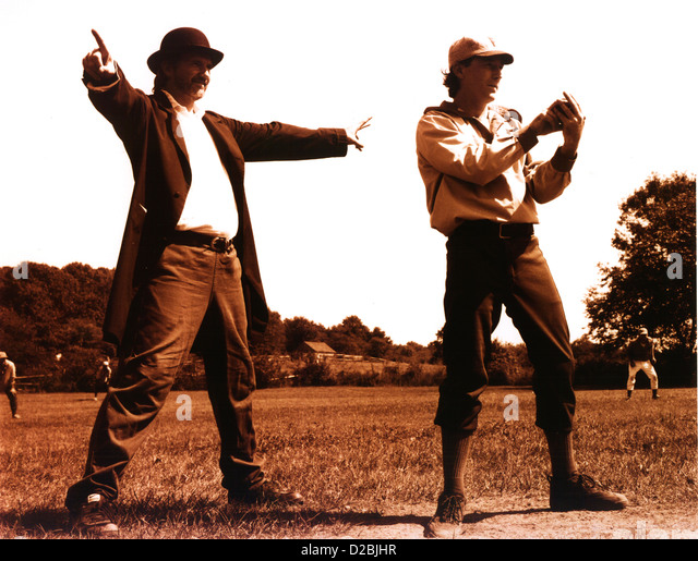 Old-Fashioned Baseball Pitcher And Umpire. Sepia-Toned. - Stock Image