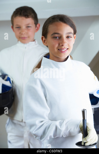 Children wearing fencing costumes - Stock Image