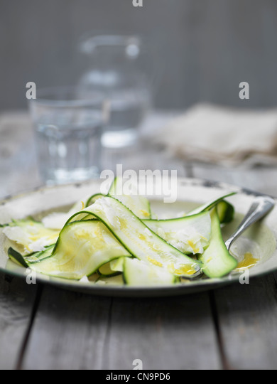 Sliced courgette with parmesan cheese - Stock Image
