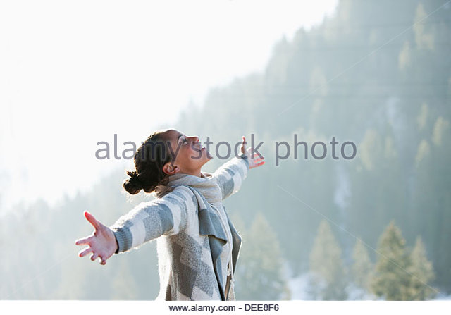 Woman with head back and arms outstretched - Stock-Bilder