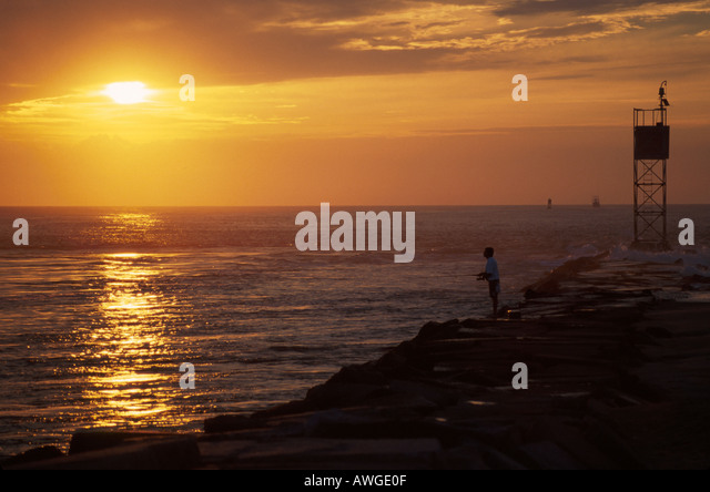 Delaware Indian River Inlet Delaware State Seashore Park fishing jetty Atlantic shore sunrise - Stock Image