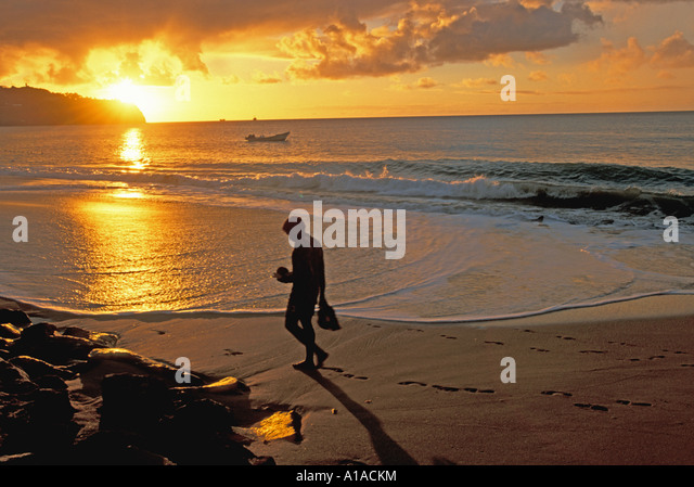 St Lucia beach sunset Man Holding Coconut Sunset on  Malabar Beach, Castries - Stock Image