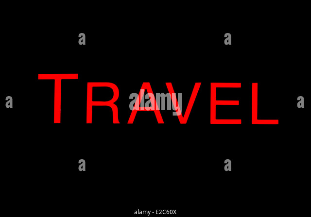 Illuminated red travel sign against a black background. - Stock-Bilder