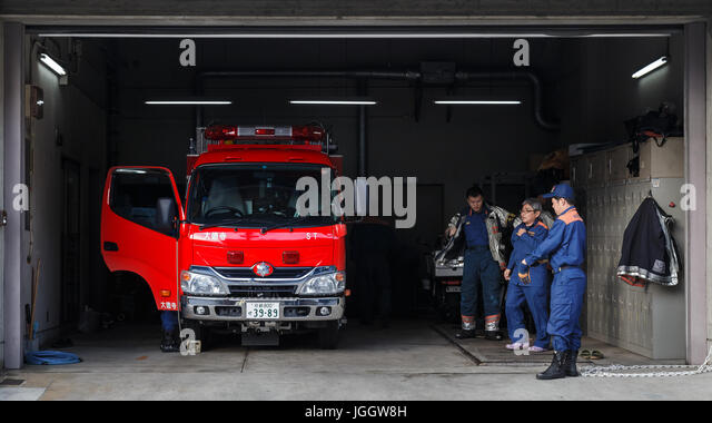 KYOTO, JAPAN - NOVEMBER 23 2015: Unidentified Japanese fire brigade in a fire station - Stock Image
