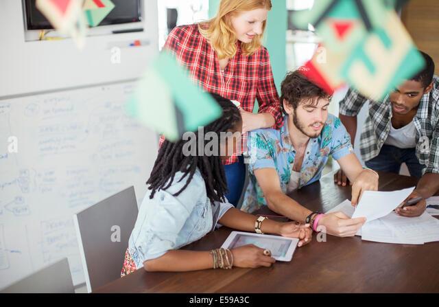 People talking in meeting - Stock Image