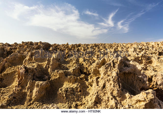 Eroded rock surface by the coast agianst the sky, low angle perspective, Cape Greco, National Forest Park, Agia - Stock Image