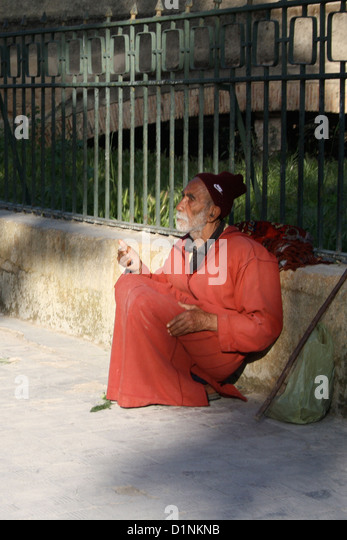 A beggar in Fes, Morocco - Stock Image