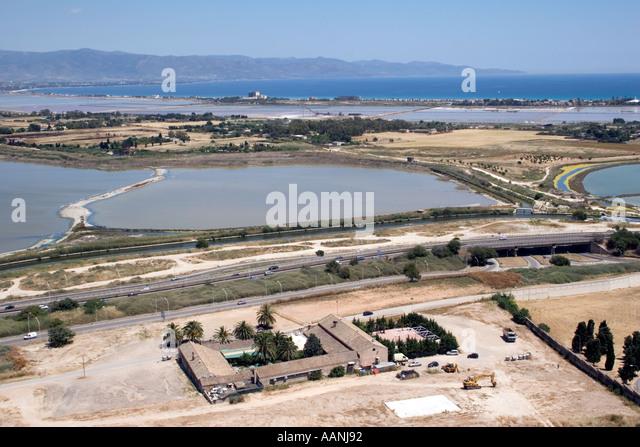 Cagliari salt flat salt pan shallow lagoon skyline landscape saltfats saltpans rural costal travel holiday vacation - Stock Image