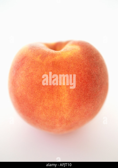 Peach on white background - Stock Image