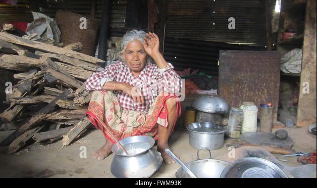 Nepal earthquake women stock photos nepal earthquake for Kitchen set in nepal