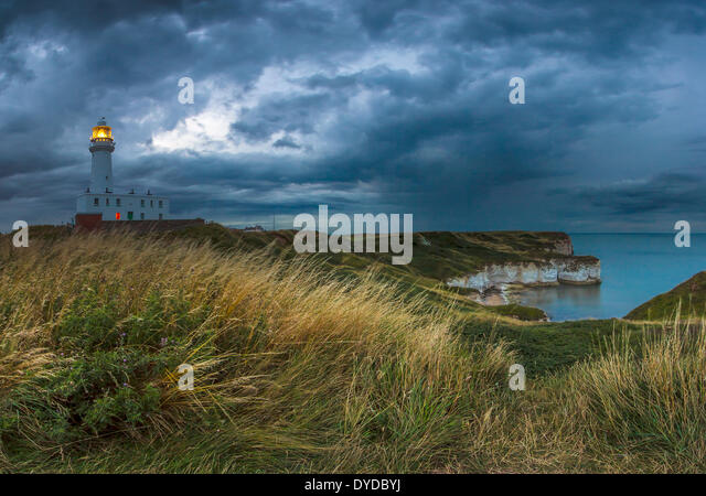 A rainstorm moves in towards Flamborough Head at twilight. - Stock Image