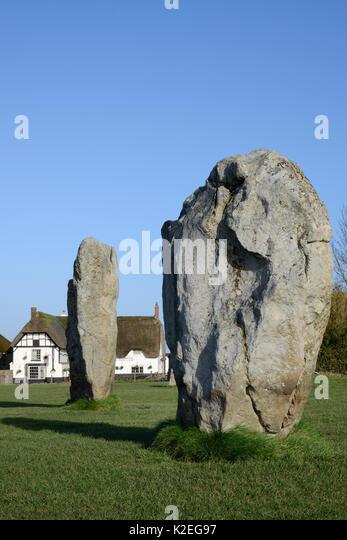 Neolithic megaliths and Red Lion Pub, Avebury Stone Circle, Wiltshire, UK, February 2014. - Stock Image