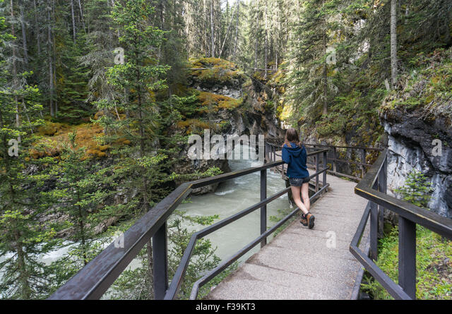 Girl standing on walkway in Johnston Canyon, Banff National Park, Canadian rockies, Alberta, Canada - Stock Image