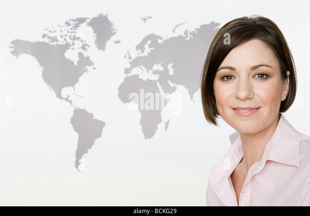 Businesswoman and world map - Stock Image
