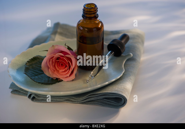 Essential oil and rose on tray - Stock-Bilder