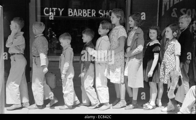 Schoolchildren waiting in line to go to the movies, San Augustine, Texas. - Stock Image