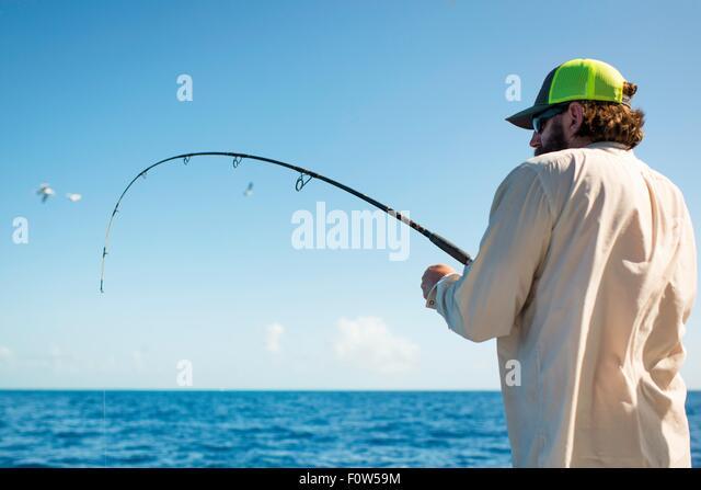 Man fishing in sea, Islamorada, Florida, USA - Stock Image