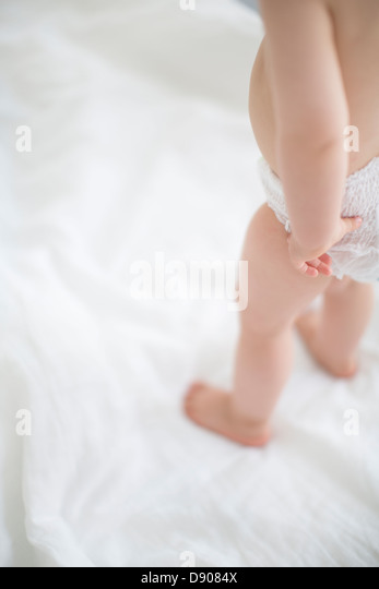 Small girl wearing diaper - Stock Image
