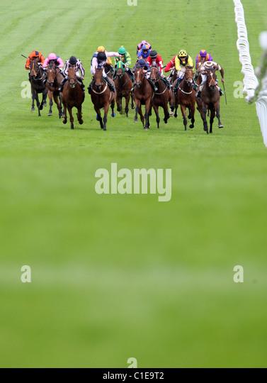 Horses and jockeys in a race, Epsom, United Kingdom - Stock Image