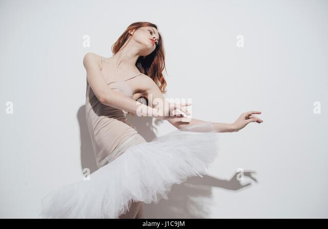 Caucasian woman dancing wearing tutu - Stock Image