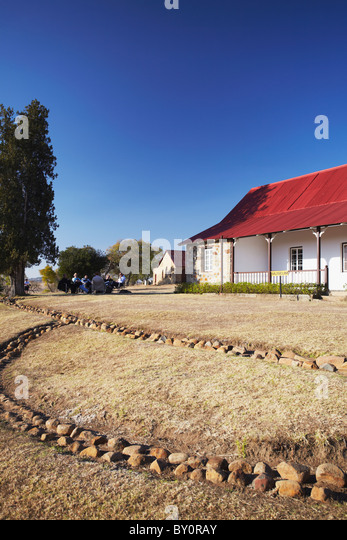 Tourists sitting outside museum at Rorke's Drift, Thukela, KwaZulu-Natal, South Africa - Stock Image