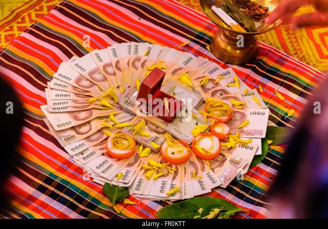 stock photo bride price money thai wedding ceremony selective focus