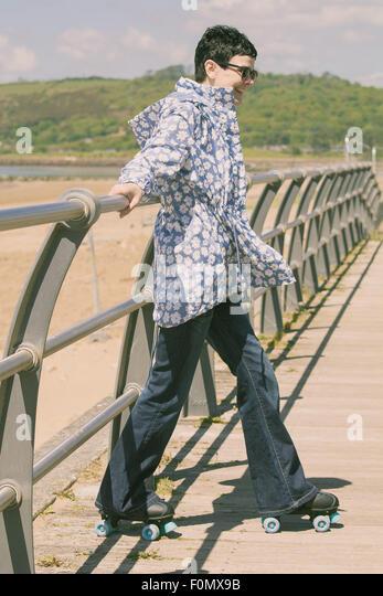 Adult on skates with 70s nostalgic vibe - Stock Image