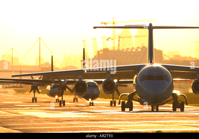 Airplanes in a queue for take off at London City airport - Stock Image