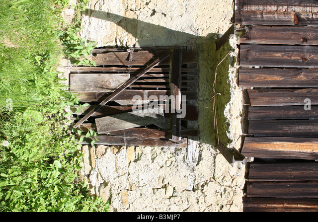 Dilapidated barn basement - Stock Image