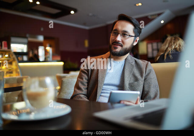 Man at cafe - Stock Image