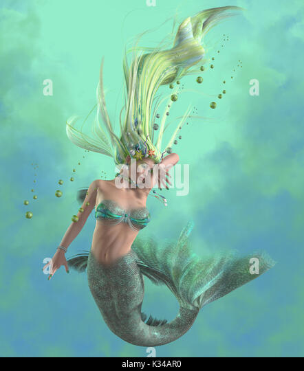 A mermaid is a mythical legendary creature composed of a beautiful woman with a fish tail. - Stock Image