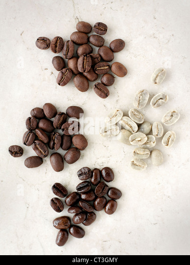 Piles of various coffee beans - Stock Image