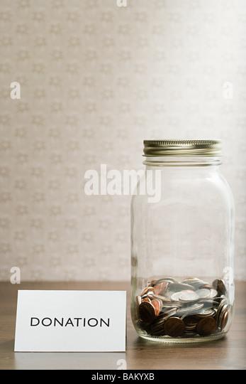 Donation jar - Stock Image