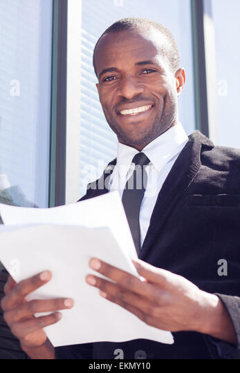 happy black businessman documents handling - Stock Image