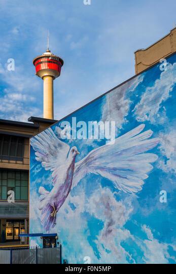 Dove mural and the Calgary Tower, Calgary, Alberta, Canada - Stock Image