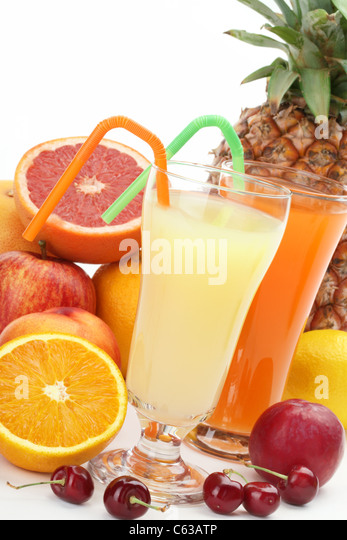 Closeup of fruit juice with fruits - Stock Image