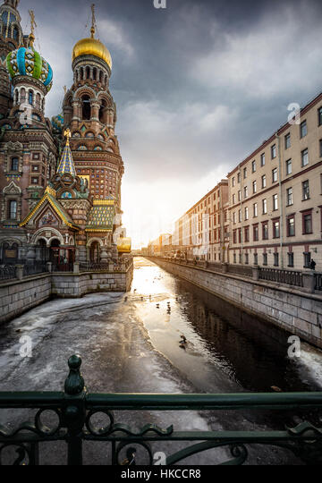 Church Savior on Spilled Blood Saint at Griboedov river and sunset sky in Petersburg, Russia - Stock Image