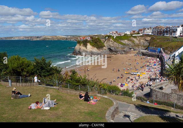 People relaxing in park above Towan beach, Newquay, Cornwall, England, United Kingdom, Europe - Stock Image