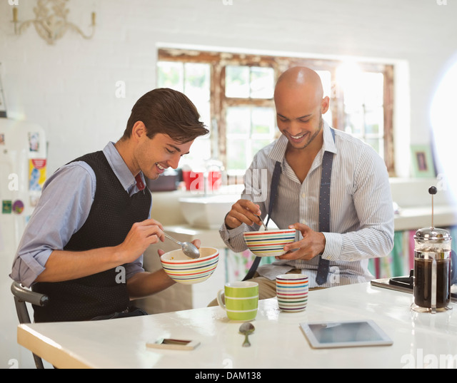 Businessmen having breakfast together - Stock Image