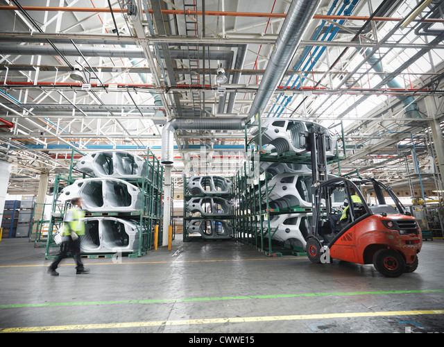 Car parts in car factory - Stock Image