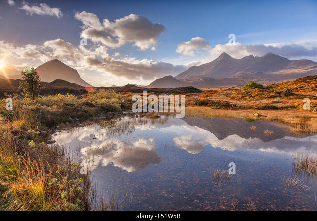 The Cuillins, autumn, at sunrise, reflected in a pool of water, Isle of Skye, Inner Hebrides, Highland, Scotland, - Stock-Bilder