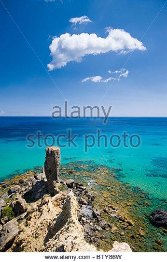 Rock pinnacle on the coast near Platja S'Aigua Blanca, Ibiza, Spain. - Stock Image