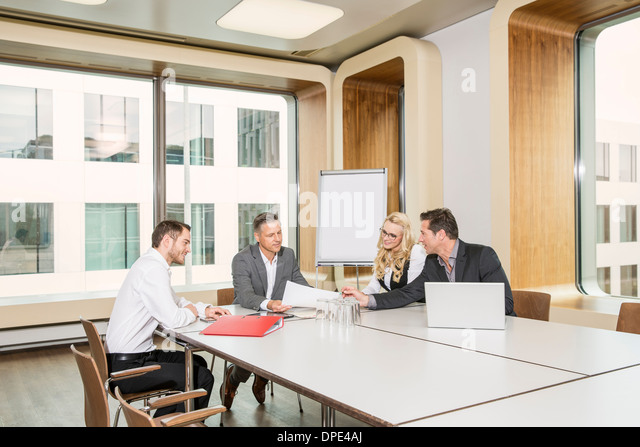 Businesspeople meeting in conference room - Stock-Bilder