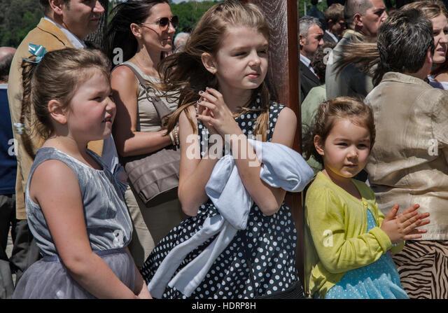 Children at Sunday Mass at Norbertine Church in Witow, village near Piotrkow Trybunalski, Western Mazovia, Poland - Stock Image