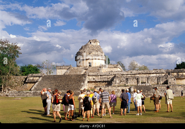 Chichen Itza The Observatory group of tourists on tour cruise excursion tourist tours Mayan archaeological site - Stock Image