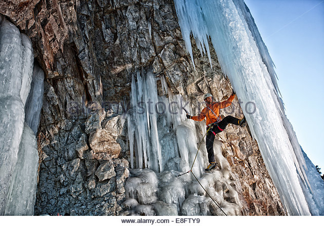 USA, Colorado, Hinsdale County, Lake City, Ice climber hanging from ice shaft - Stock Image