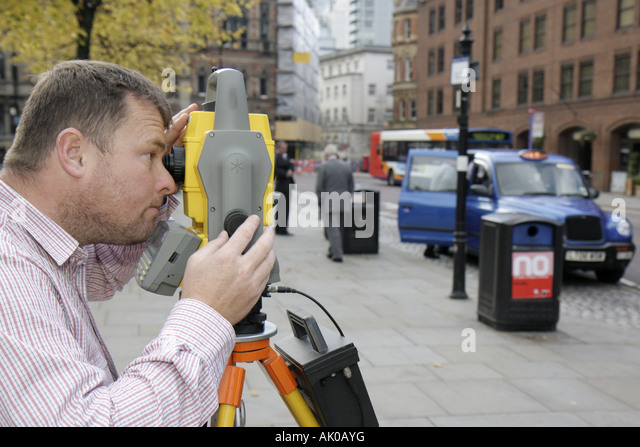 UK, England, Manchester, Albert Square, male surveyor, job, measure, - Stock Image