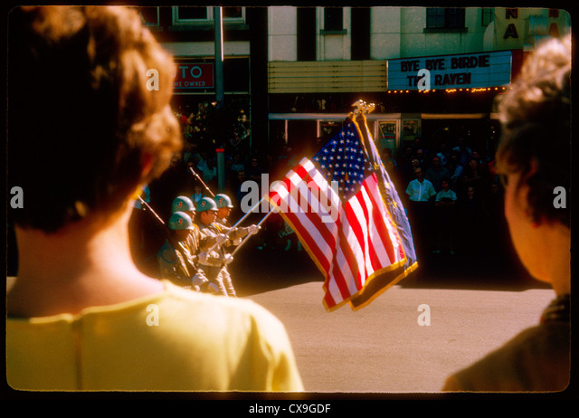 national guard members carrying flag during 1963 fall festival parade martinsville indiana 1960s - Stock Image